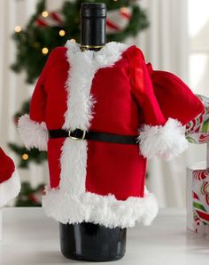 Santa brings kids all kinds of cool presents at Christmas time, but what do the adults get? Maybe a glass of wine after the kids have opened up all of their gifts. And that drink will be all the sweeter with this Santa Suit Wine Bottle
