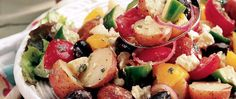 Olives, feta, tomatoes and a garlicy, lemon-Dijon dressing turn potato salad into a great Greek salad.