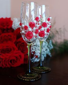 Wedding toasting glasses, hand decorated with an original design in red and gold. Personalized wedding glasses.