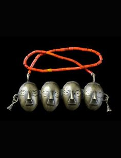India   Pectoral necklace with trophy heads from the Naga people; brass (lost cast method), glass beads on natural fiber cord   Up to this day the Konyak village of Wangti ranks as one of the most important production centres for this type of necklace. They are sold throughout the eastern and northern Naga territory.   Est. 300 - 600€ ~ (Oct '15):