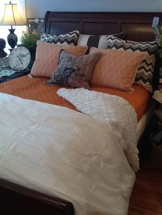 Love this new bed in Grays and Orange!  #Eastern Accents Euro Shams and Standard Shams matched up with #Company C persimmon quilt and finished with #Pine Cone Hill's Mod Pintuck Duvet and the Candlewick chenille throw.  LOVE this one!