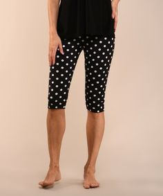 bcae05f76e9440 Another great find on #zulily! Black & Ivory Polka Dot Capri Leggings -