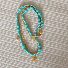 Turquoise Necklace with gold plated charms and angel by CharmByIA, $45.00