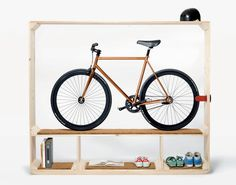I'm not a fan of hanging bikes by the wheel, especially if they're made of expensive carbon or other light weight material. Here's the next best solution in keeping all your toys in one place!