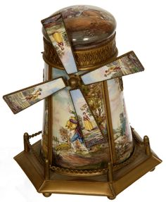 Windmill Music box featuring French enamel courting scenes.  http://www.woodyauction.com/K%20Rieger%20Gray%20Photos/web/k58.jpg