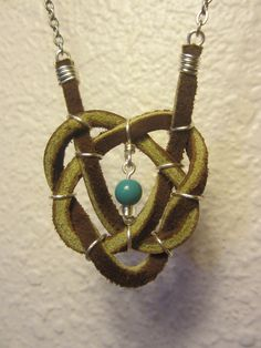 Leather and wire Celtic Heart Knot necklace (Lighting makes the leather look green but its not!).
