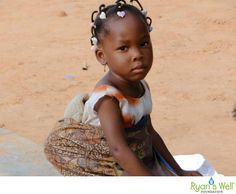 A young girl from Klikame School in Togo, carrying her pretend baby - 2012