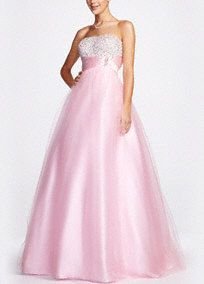 Feel like a princess in this stunning tulle prom dress!  Strapless bodice is adorned with beautiful beading.  Tulle skirt is fabulous and ultra feminine.  Empire sash cinches the waist creating a flattering silhouette.  Fully lined. Back zip. Imported polyester. Dry clean.  Also available in Plus sizes. Style DB027W  David's Bridal exclusive style.