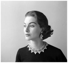Nancy Berg wearing a sweater with a pearl necklace collar, September 1952. Photo by Nina Leen.