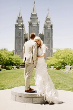 Don't like the dress but I like the picture. I think it would be really cute if they were both turned around looking at the temple holding hands.