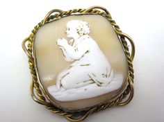A stunning large antique carved shell cameo featuring a child praying. The carving is lovely and these are quite rare to find. It could be a boy