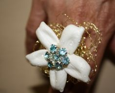 We custom design rings for a new, fun way to wear flowers.