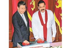 President Mahinda Rajapaksa and Chinese President Xi Jinping are seen commissioning the last phase of the Norochcholai Lakvijaya Power Plant last evening at a joint event that linked the Presidential Secretariat with Norochcholai via a fibre optic network. Picture by Sudath Silva