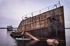 hula paints a floating female on a sunken ship in hawaii while surfing