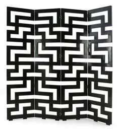 Modern, elegant and unique, this timeless geometric maze Christopher Guy design, stunning in black lacquer, adds style to any setting.
