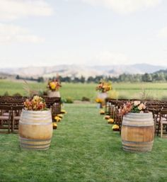 Fall outdoor wedding - love the rustic barrels