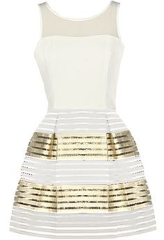 Party Favor Dress: Features a sheer mesh yoke with a subtle sweetheart neckline, solid white bodice with keyhole closure to the back, and a lustrous A-line bandage skirt with gold accent to finish.