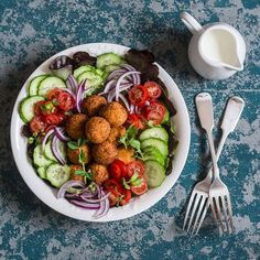 This Easy Baked Falafel Salad Recipe Makes Lunch Meal Prep a Breeze This dietitian-approved baked falafel salad is a delicious, healthy way to reap the benefits of the plant-based protein from chickpeas.