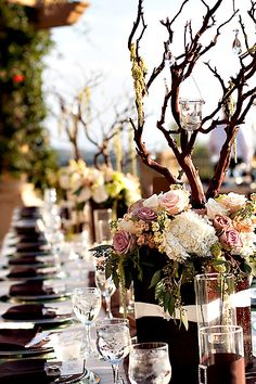 Brown-and-Purple-Wedding-Centerpiece branch with flowers surrounding it