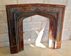 Antique Cast Iron Fireplace Insert by AsIsRepurposedItems on Etsy https://www.etsy.com/listing/129929141/antique-cast-iron-fireplace-insert