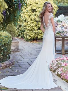 Rebecca Ingram - naomi, Soft lace adorns the bodice of this elegant wedding gown, with sheer lace comprising the illusion off-the-shoulder sleeves and accenting the sweetheart neckline and illusion scoop back. Sheath silhouette feautres Talin-stretch crepe skirt. Finished with covered buttons over zipper closure.