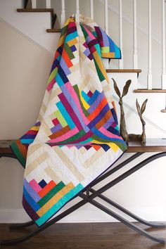 Oversized log cabin quilt blocks create the bold design in this fat quarter friendly quilt pattern.