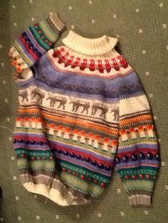Pullover made of wool. Idea is from Lappland. All colours are picked from Lappland wilderness. There are reindeers , berries and mushrooms. All colours from autumn nature. Sky covered with northern lights.