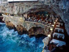 a Mare in southern Italy (province of Bari, Apulia), lies a most unique dining experience at the Grotta Palazzese.Polignano a Mare in southern Italy (province of Bari, Apulia), lies a most unique dining experience at the Grotta Palazzese. Most Romantic Places, Beautiful Places, Amazing Places, Amazing Hotels, Exotic Places, Beautiful Hotels, Beautiful Gorgeous, Stunning View, Wonderful Places
