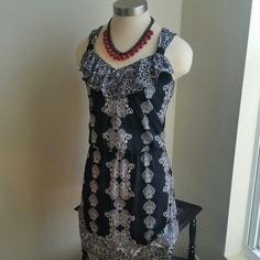 """WHBM...BEAUTIFUL BLACK /WHITE  DRESS. EXCELLENT CONDITION.... .this dress is really nice...I love the design to it ...has cute ruffles on chest.. front and back..color is black with white and nice design...95%polyester 5%spandex. ...better in person could be worn for any occasion. .size  x small...but fits more like size small. ...better in person...LENGTH 34"""" ....... White House Black Market Dresses"""