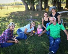 Joey's mom, dad, sisters, and Indy visiting her grave.