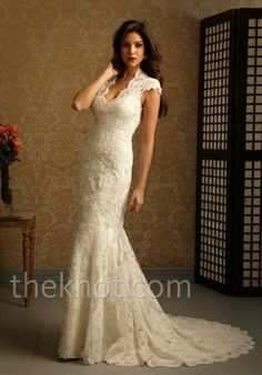 Deep V-neck lace wedding gown with capped sleeve