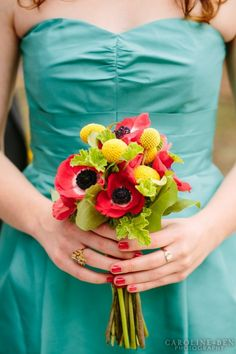 red anemones, yellow craspedia bouquet