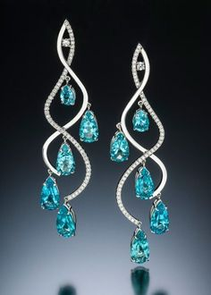 Stilla earrings with rare Madagascar apatite by Adam Neeley.