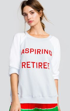 """Join the aspiring retiree club. The Sommers Sweater is a vintage inspired sweater. Color blocked long sleeves, crew neck and banded hems. Features flocking on graphic. Constructed from a lightweight french terry.  In Blue Pearl/Clean White. 50% Cotton, 50% Polyester  Model wears a size small Length: 24 1/2"""" Chest: 23"""""""