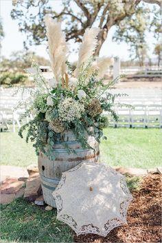 rustic whiskey barrel idea wedding decor / http://www.deerpearlflowers.com/rustic-wedding-details-ideas-you-will-love/2/
