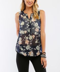Whether layered beneath your favorite cardigan or worn alone on a warm day, this polished top exudes put-together style.Juniors: S = 1 - 3, M = 5 - 7, L = 9 - 11, XL = 13 - 15, XXL = 17Women: S = 0 - 2, M = 4 - 6, L = 8 - 10, XL = 12 - 14, XXL = 16100% polyesterHand washImported