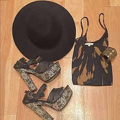 Gorgeous Black & Tan Printed Tank Totally adorable tank by Old Navy. Size small and runs pretty true to size; cotton top. ✳️make an offer!  ✳️bundle for extra savings! ✳️ask me to check out your closet/trade! Old Navy Tops Tank Tops