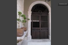 """Traditional antique """"Cancel"""" or main doorway"""