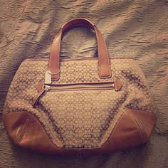 Coach purse Luggage color leather and cloth signature Coach purse. Only worn a few times. Great condition. Coach Bags
