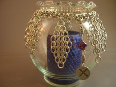 Candlelight and Diamonds - A Chain Maille Love Rune Candle Holder. $30.00, via Etsy.