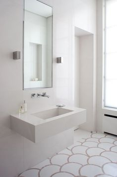 White and bright bathroom, like the contrast/detailed flooring and basin - shame…