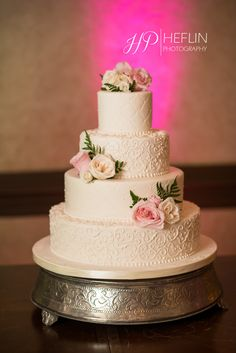 Cake decorated with blush and white roses. Simple perfection.