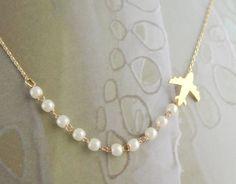 airplane necklace. $18.00, via Etsy.