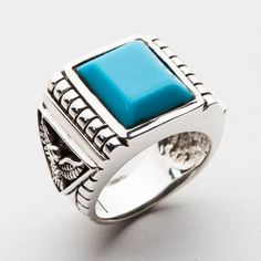 We've crafted this Genuine Turquoise Eagle Mens Ring of sterling silver and placed a giant square turquoise stone in its center. Eagle carvings adorn the sides Mens Silver Necklace, Sterling Silver Mens Rings, 925 Silver, Mens Turquoise Rings, Turquoise Stone, Turquoise Jewellery, Gothic Rings, Rocker, Silver Man