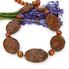 The spectacular semi precious gemstones used in the one of a kind MOTHER NATURE'S FIREWORKS handmade necklace look like brilliant sprays of starburst fireworks.  Although the gemstone is called starburst jasper (also chrysanthemum jasper and spider jasper), it is actually not a jasper at all but a type of rhyolite formed during volcanic activity.