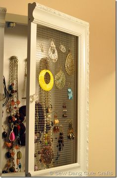 I've got all my earrings hanging from an old tshirt... this idea is more work than i have ambition for, but i love the idea of attaching chicken wire to a painted frame <3