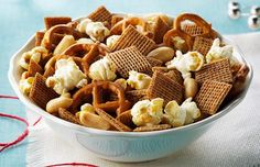 Always a party favorite, this crunchy snack mix with Post Shreddies(R) Cereal, popcorn, pretzels, and peanuts is ready in no time. Snack Mix Recipes, Sweets Recipes, Dog Food Recipes, Snack Mixes, Savoury Recipes, Quick Snacks, Yummy Snacks, Yummy Treats, My Favorite Food