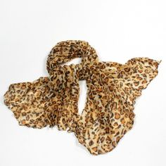 http://www.artfire.com/ext/shop/studio/bohemiantouch/1/1/10311//  Leopard Shawl Celebrity Look Yellow Orange Tone Soft Touch Fashion Shawl Scarf, scarf is a great addition to your collection of fashion accessories. Perfect for all year round.