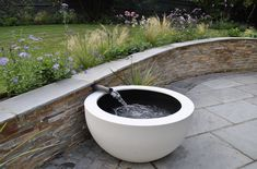 Running water is a great way of providing a pleasant backing track to any garden setting