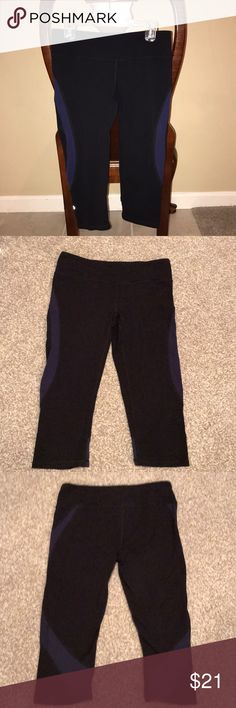 Alo yoga Capri leggings Alo yoga black and purple  Capri leggings with cool mesh detail. Size small! Good condition over all with slight wear. Small area of pilling around crotch area as seen in above photo. Lots of life left in these amazingly comfortable and cute Alo yoga capris! ALO Yoga Pants Leggings